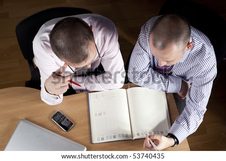 Two businessmen working at notebook