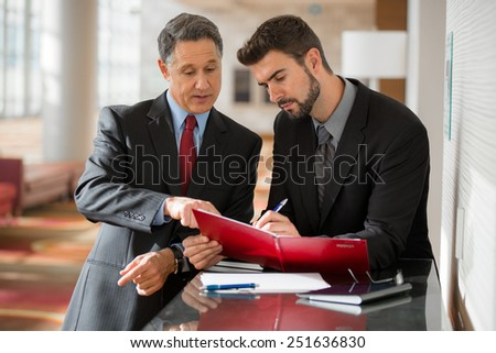 Two businessmen working at the office  - stock photo