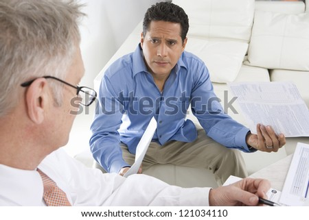Two businessmen working on financial expenses