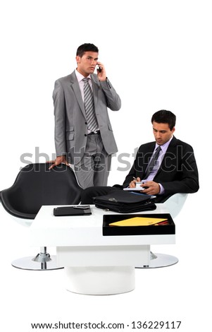 Two businessmen working together.