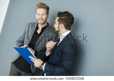 Two businessmen working together in the office - stock photo