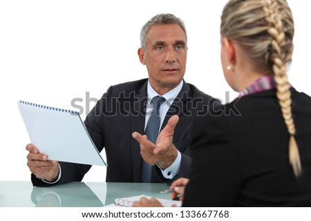 Two businesspeople discussing. - stock photo