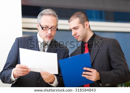 Two businesspeople discussing
