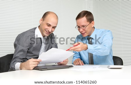 two businesspeople having a discussion in office - stock photo