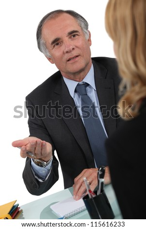 Two businesspeople having discussion
