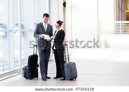 two businesspeople meeting at airport - stock photo