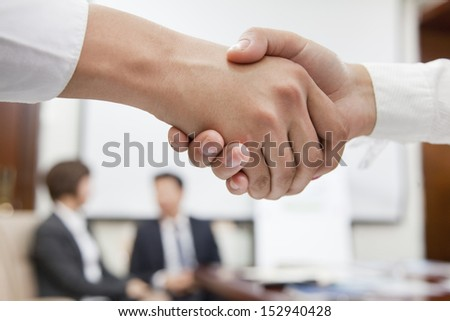 Two Businesspeople Shaking Hands - stock photo
