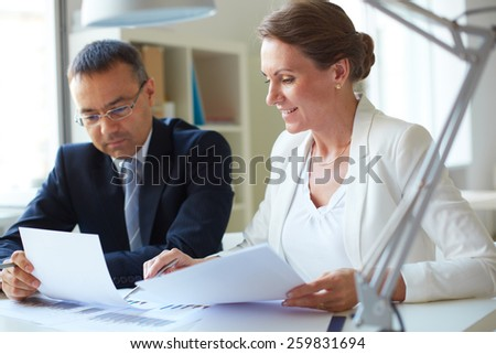 Two businesspeople sharing information - stock photo