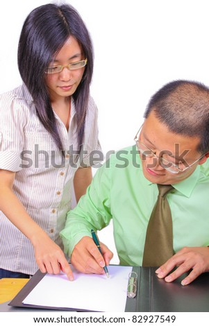 Two businesspeople signing a letter