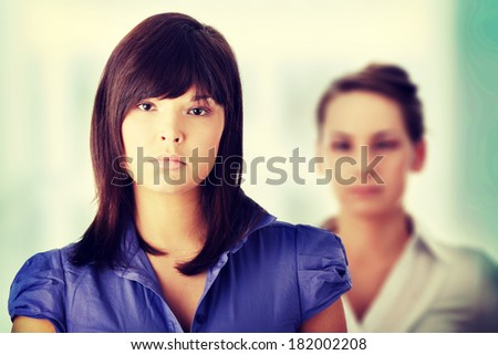 Two businesswoman in office portrait - stock photo