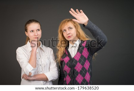 Two businesswoman near empty visual screen. - stock photo