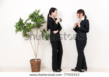 two businesswoman relaxing