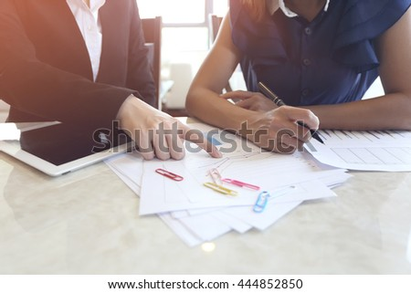 Two businesswoman working in office.