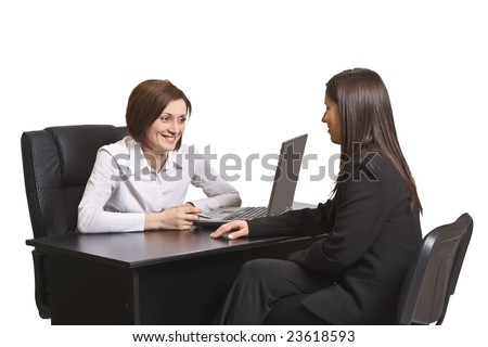 Two businesswomen at an interview in an office.The documents on the desk are mine.