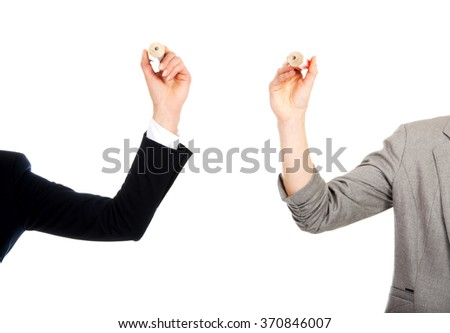 Two businesswomen holding pencils.