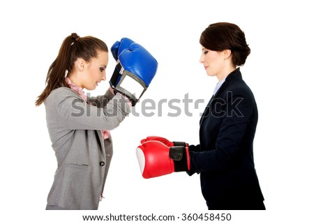 Two businesswomen with boxing gloves. - stock photo