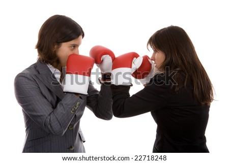 two businesswomen with boxing gloves fighting. isolated on white background. - stock photo
