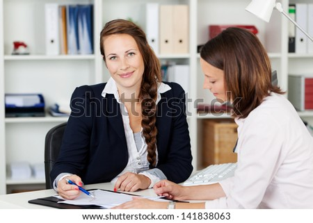 Two businesswomen working together inside the office