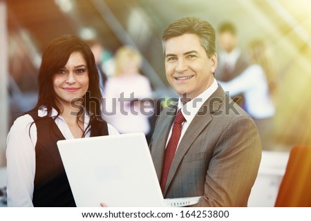 Two bussiness partnersman and woman over team background - stock photo