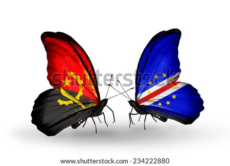 Two butterflies with flags on wings as symbol of relations Angola and Cape Verde - stock photo