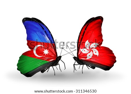 Two butterflies with flags on wings as symbol of relations Azerbaijan and Hong Kong - stock photo