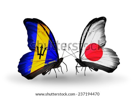 Two butterflies with flags on wings as symbol of relations Barbados and Japan - stock photo