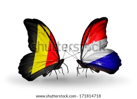 Two butterflies with flags on wings as symbol of relations Belgium and Holland - stock photo