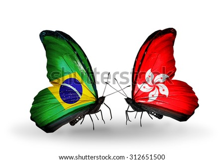 Two butterflies with flags on wings as symbol of relations Brazil and Hong Kong - stock photo