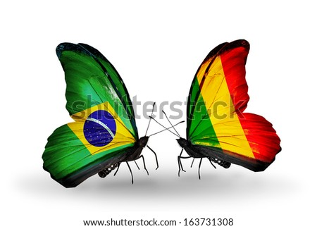 Two butterflies with flags on wings as symbol of relations Brazil and Mali - stock photo