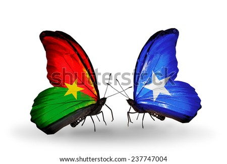 Two butterflies with flags on wings as symbol of relations Burkina Faso and Somalia - stock photo