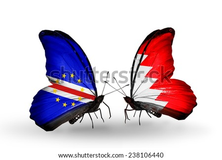 Two butterflies with flags on wings as symbol of relations Cape Verde and Bahrain - stock photo
