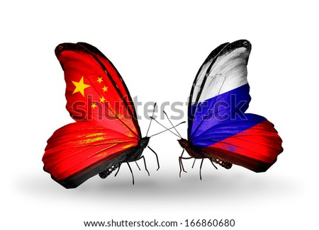 Two butterflies with flags on wings as symbol of relations China and Russia - stock photo