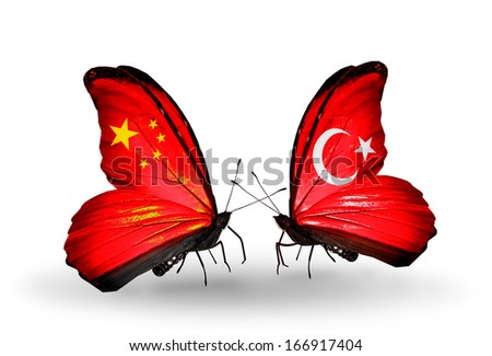 Two butterflies with flags on wings as symbol of relations China and Turkey - stock photo