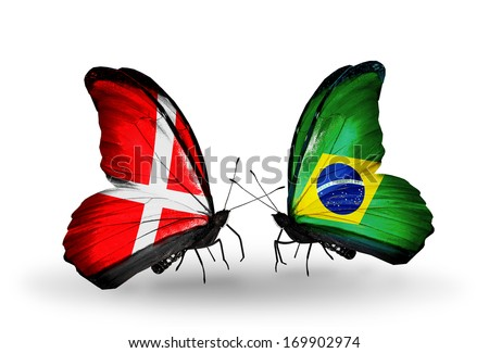 Two butterflies with flags on wings as symbol of relations Denmark and Brazil - stock photo