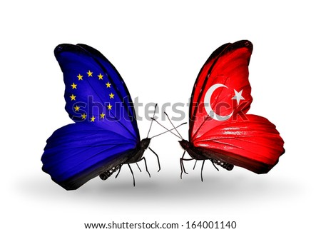 Two butterflies with flags on wings as symbol of relations EU and Turkey - stock photo