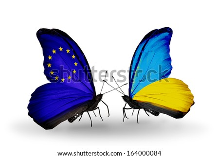 Two butterflies with flags on wings as symbol of relations EU and Ukraine - stock photo