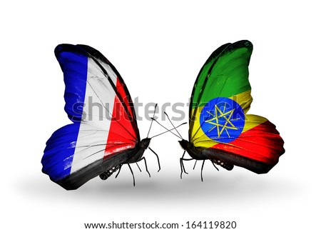Two butterflies with flags on wings as symbol of relations France and Ethiopia - stock photo