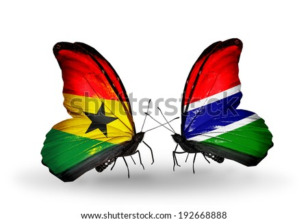 Two butterflies with flags on wings as symbol of relations Ghana and Gambia - stock photo