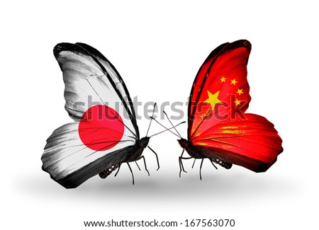 Two butterflies with flags on wings as symbol of relations Japan and China - stock photo