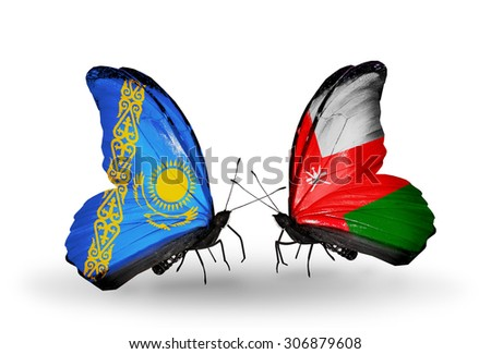 Two butterflies with flags on wings as symbol of relations Kazakhstan and Oman - stock photo