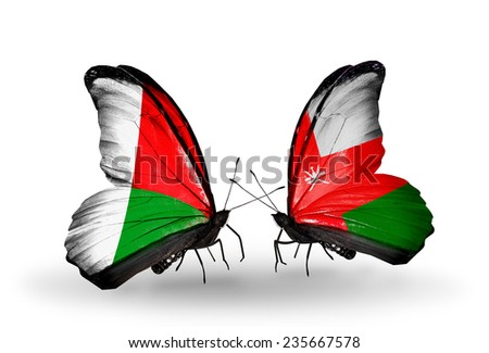 Two butterflies with flags on wings as symbol of relations Madagascar and Oman - stock photo