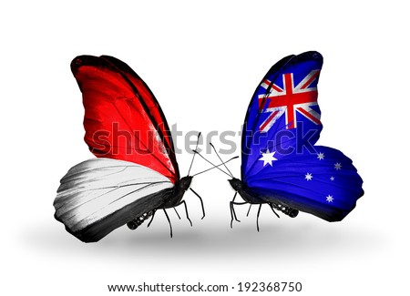 Two butterflies with flags on wings as symbol of relations Monaco, Indonesia and Australia - stock photo