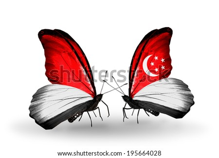 Two butterflies with flags on wings as symbol of relations Monaco, Indonesia and Singapore - stock photo