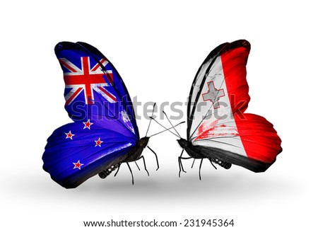 Two butterflies with flags on wings as symbol of relations New Zealand and Malta - stock photo