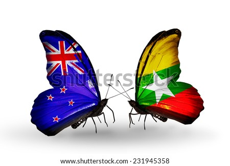Two butterflies with flags on wings as symbol of relations New Zealand and Myanmar - stock photo