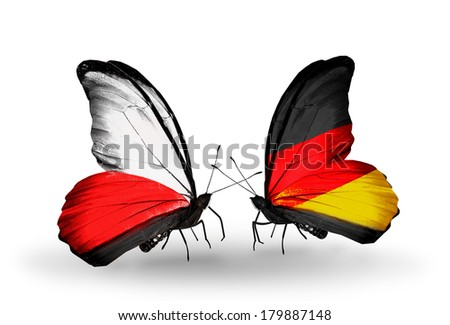 Two butterflies with flags on wings as symbol of relations Poland and Germany - stock photo