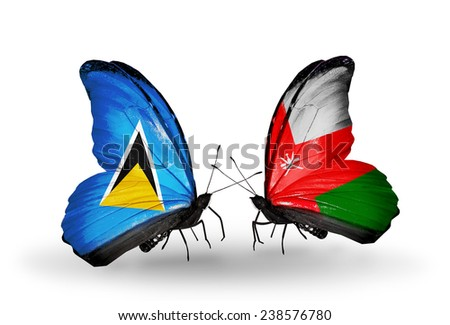 Two butterflies with flags on wings as symbol of relations Saint Lucia and Oman - stock photo