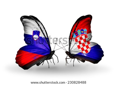 Two butterflies with flags on wings as symbol of relations Slovenia and Croatia - stock photo