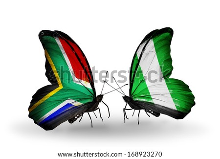 Two butterflies with flags on wings as symbol of relations South Africa and Nigeria - stock photo