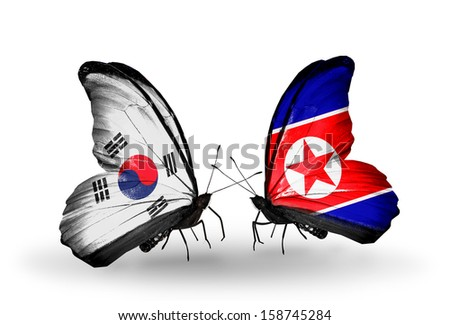 Two butterflies with flags on wings as symbol of relations South Korea and North Korea - stock photo